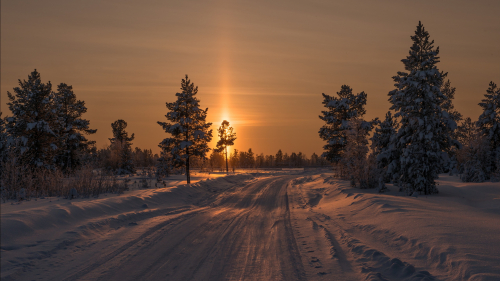 Beautiful Winter Snowed Road and Sunset