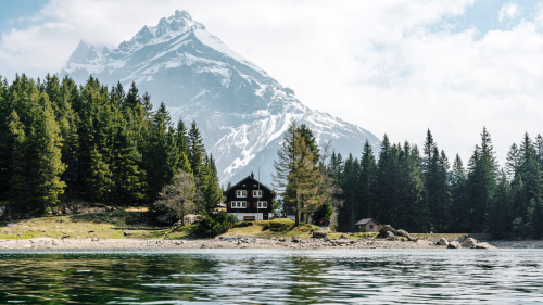 Single House on River and Mountains